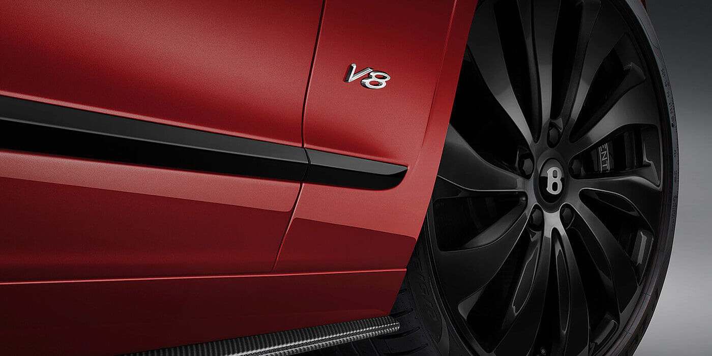 new-Bentley-Flying-Spur-V8-in-Dragon-Red-2-paint-colour-with-black-wheel-and-V8-badge